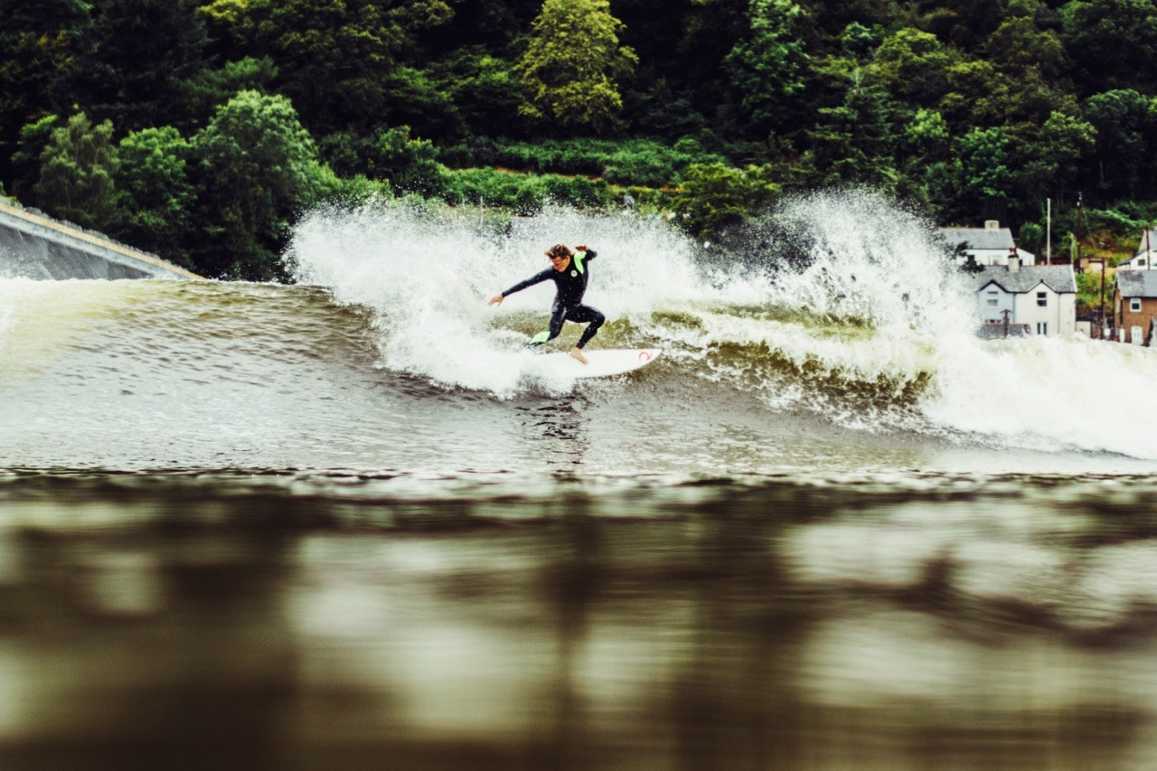 Jayce Roinson with a smooth cutback on a right at Surf Snowdonia in North Wales