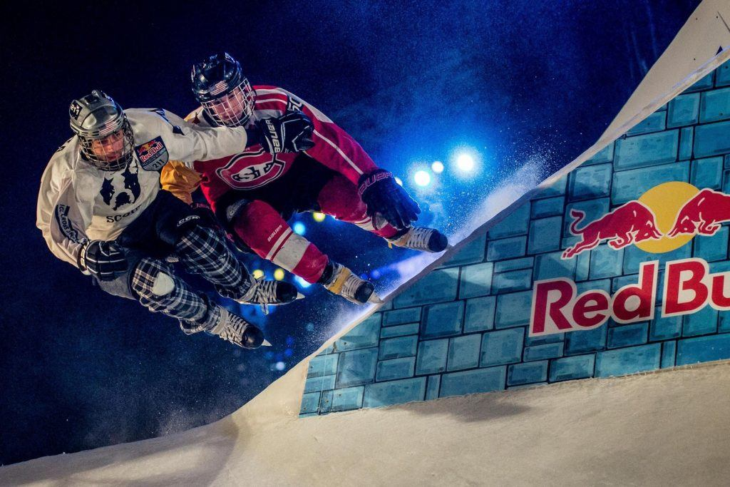Matt Johnson (right) competes against Chris Barta (left) at Red Bull Crashed Ice Championship. Photo credit: Red Bull