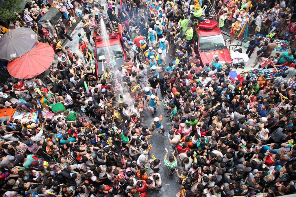 Top 6 Life-Changing Festivals to See in Thailand. Locals and visitors spray each other at the Songkran Festival in Chiang Mai Photo credit- Tourder's