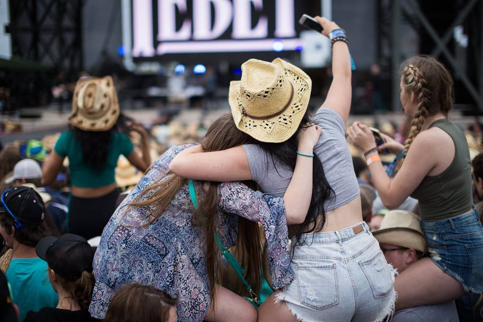 Country Music Fans in the crowd at Cavendish Beach Music Festival one of the best outdoor music festivals in north america