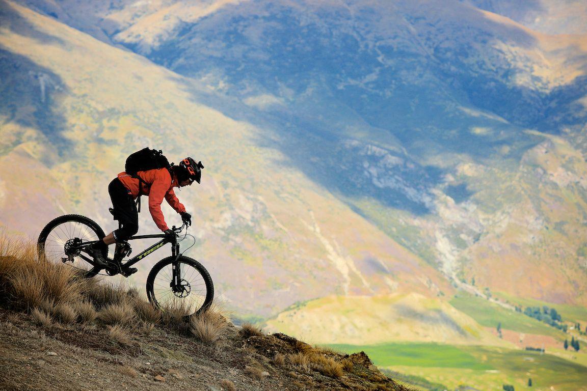 Fat Tyre Mountain Biker riding downhill. Heli-Biking In New Zealand. Photo credit Fat Tyrpe Adventures