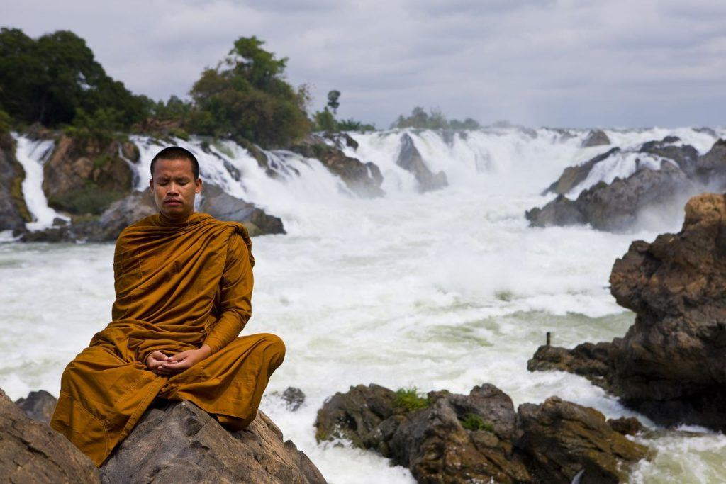 Meditating at Khon Phapheng Waterfall, Siphandon in Laos backpacking the asian trail