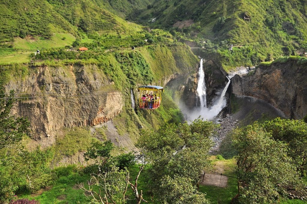 above the waterfalls in a cage over BAÑOS, Ecuador