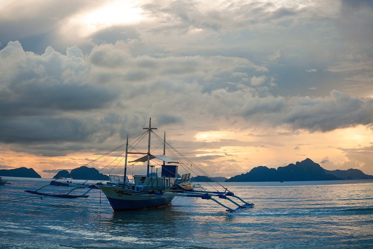 island adventures in the Philippines take out a boat on sunset