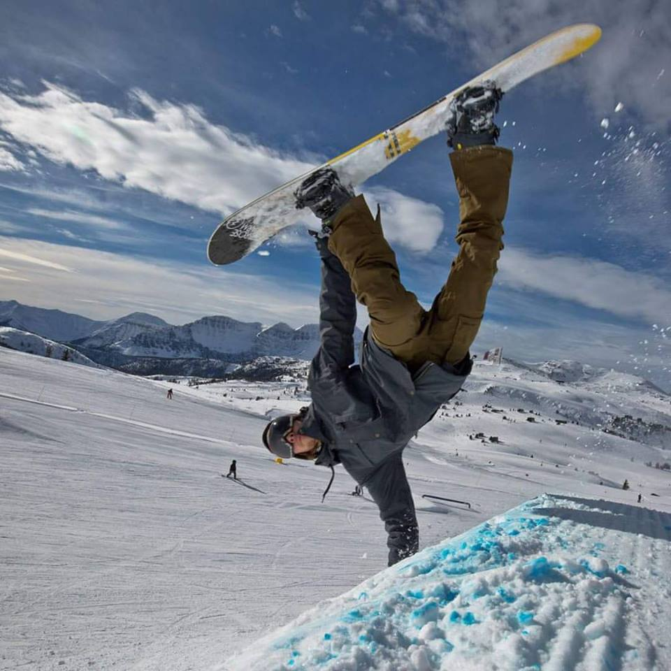 snowboarder hand plant in the park on your snow holidays