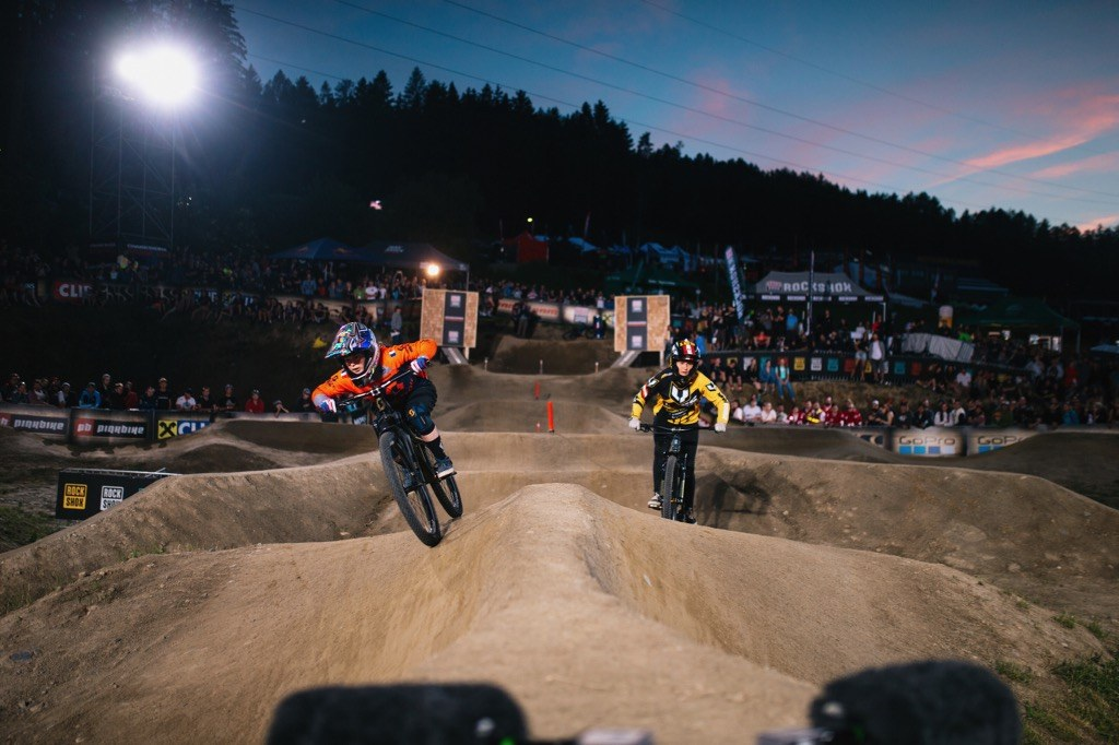 Mathilde Bernard and Vanessa Kager battle it out for 2nd and 3rd place during the Crankworx Pumptrack Challenge in Innsbruck, Austria on June 13th, 2019