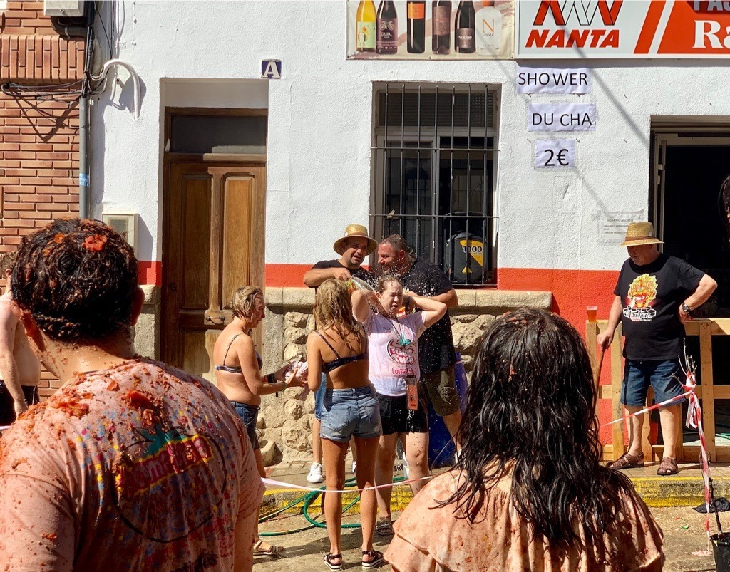 Locals offering to hose you down after La Tomatina