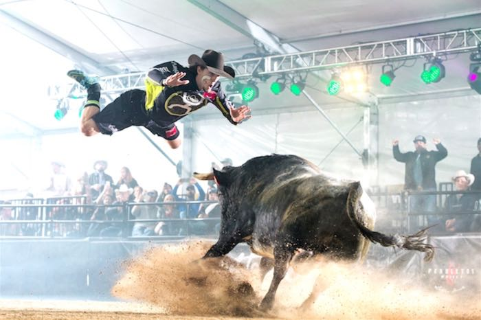 Rodeo Austin jumping over a bull
