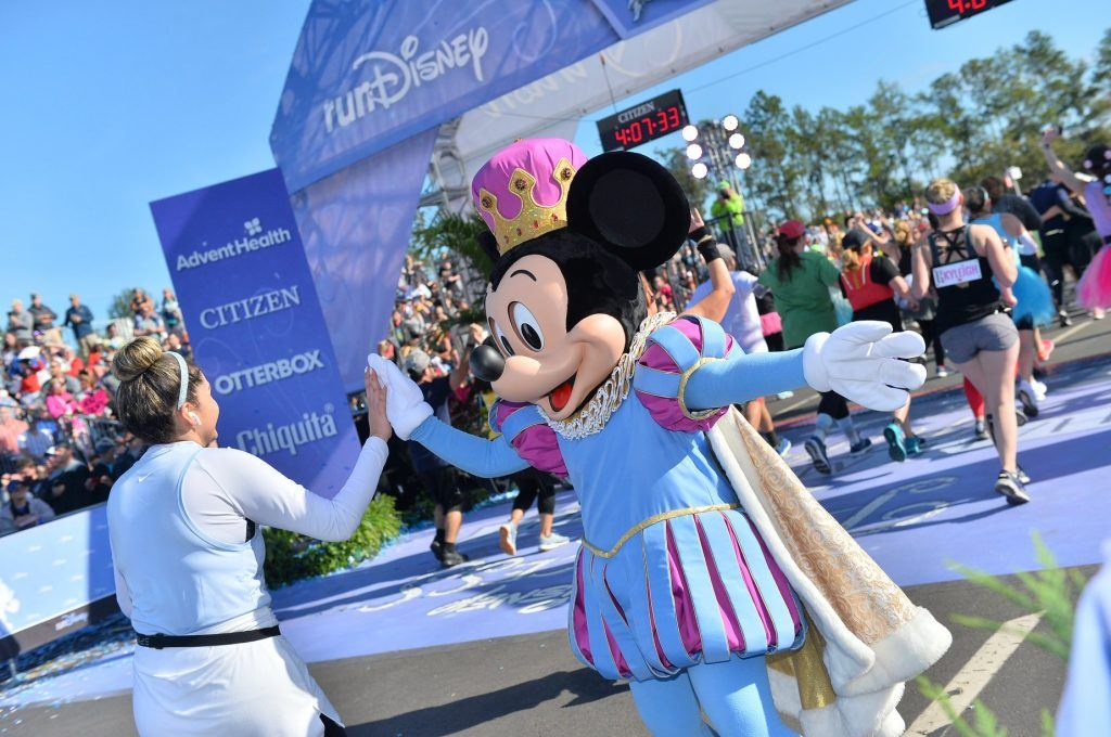 Greeted by Mickey Mouse at the finish line