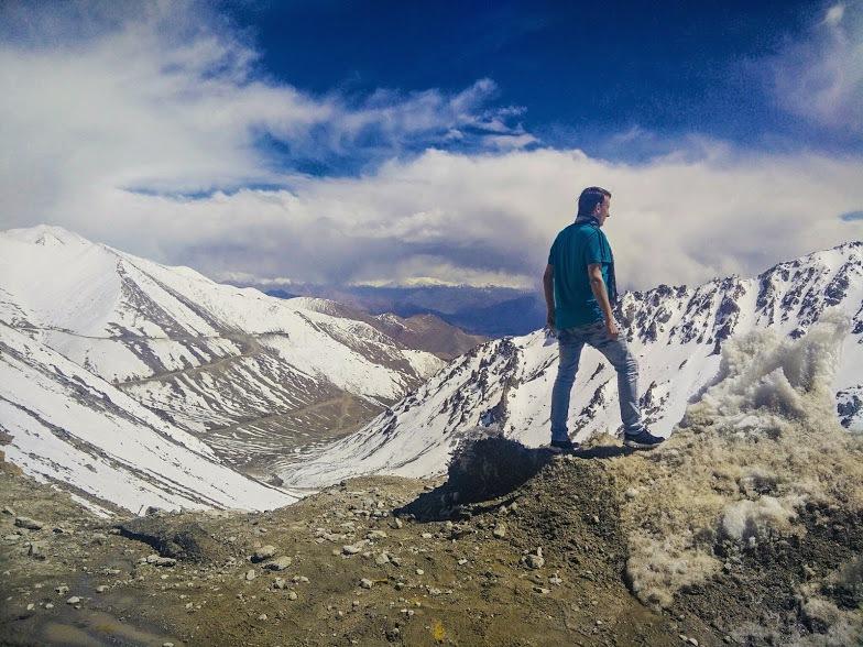 man standing on top of stok kangri daring adventure in Kashmir