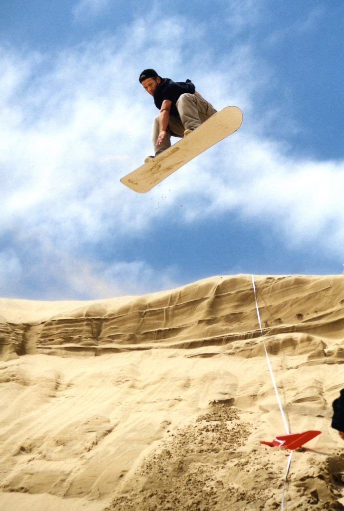 Sandboarding cliff jump