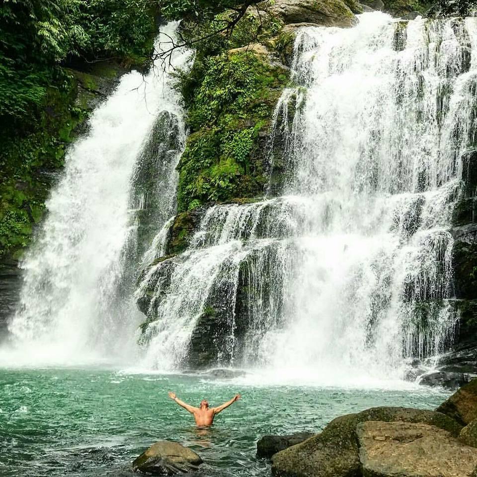Waterfall jumping in Costa Rica
