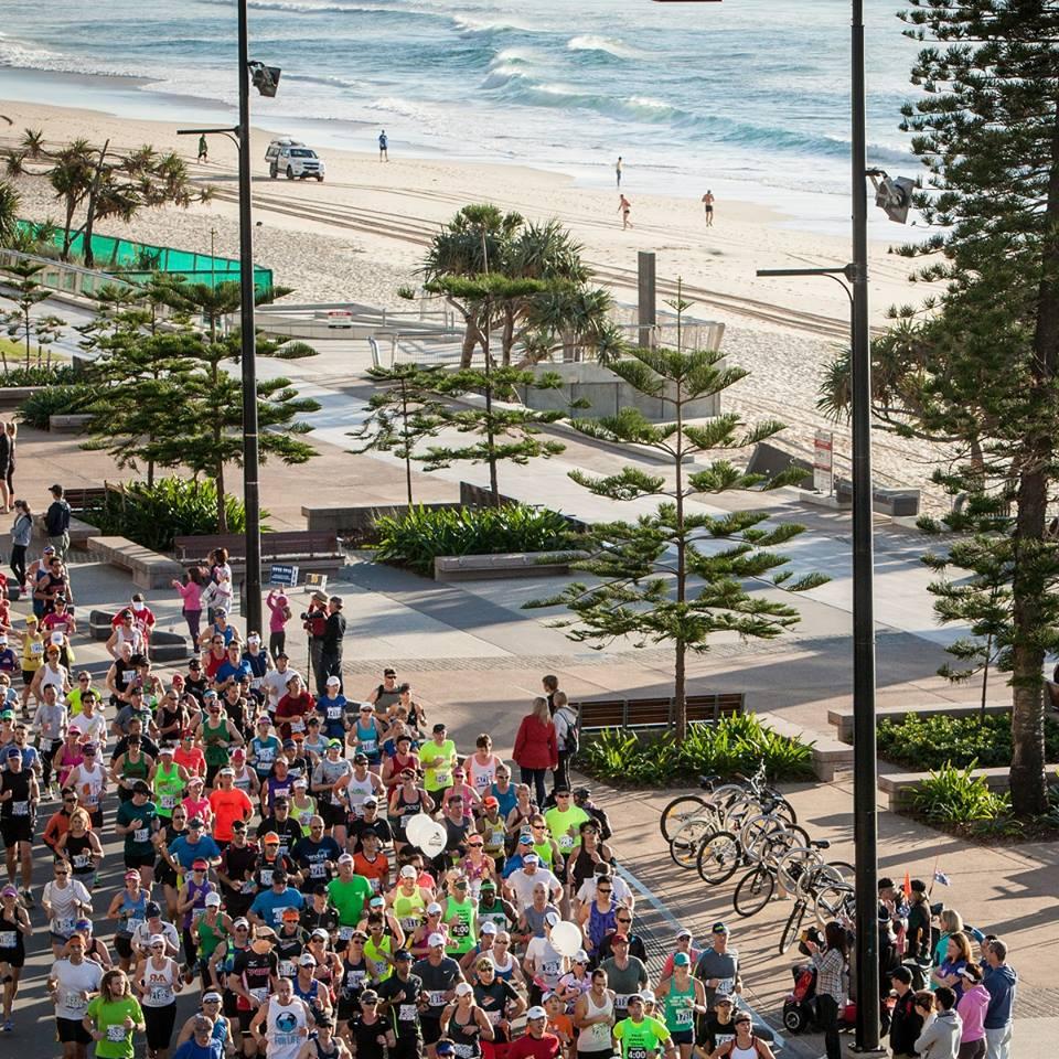 gold coast marathon runners by the beach