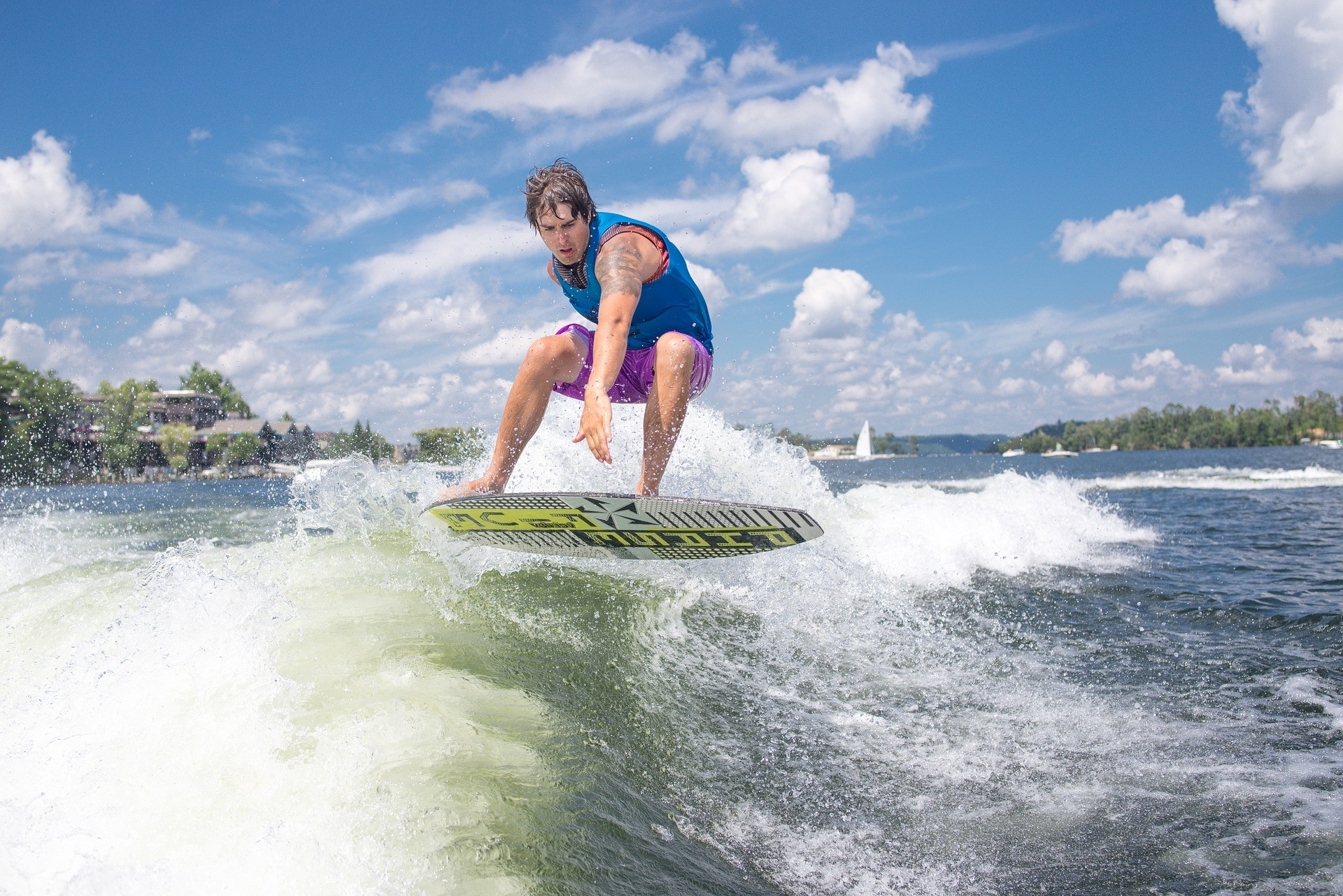 Action Sports Lessons for Entrepreneurs wake surfing behind a boat