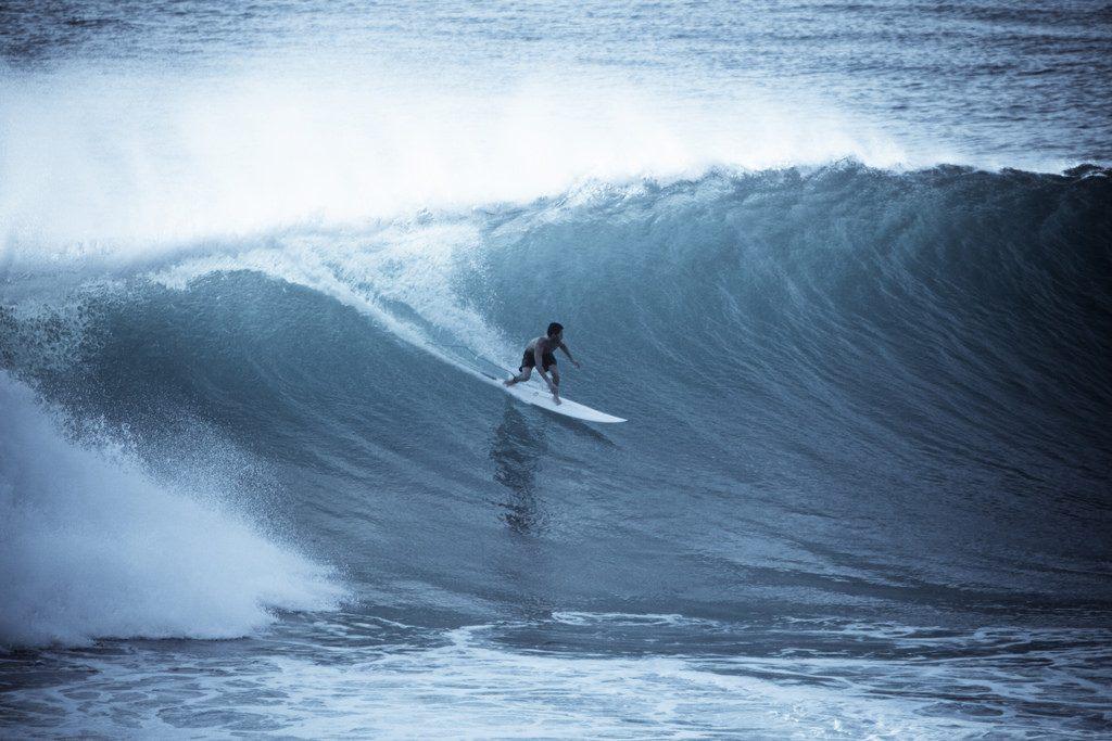 Surfer at UIuwatu in Bali