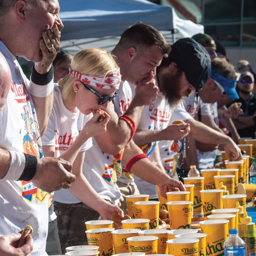 Eat as many hot dogs as you can in 10 minutes at Nathan's Hot Dog Eating Contest