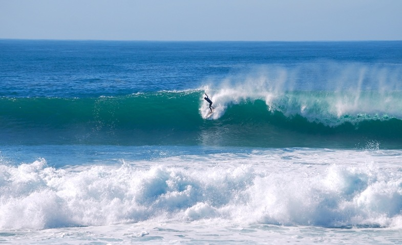 Surfer dropping into a wave at Buarcos best surf beaches in Portugal