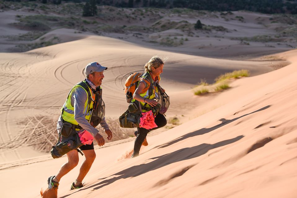 runners up a sand dune in Grand to Grand Ultra