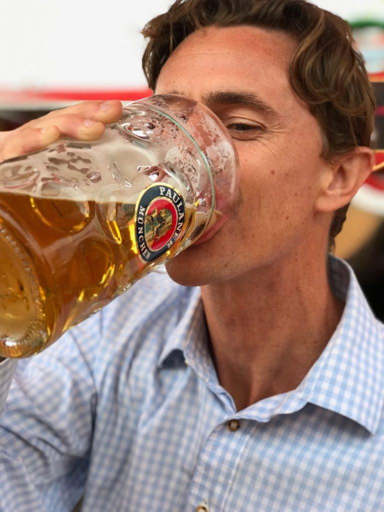 Oli Russell-Cowan drinking a mass of beer at Springfest