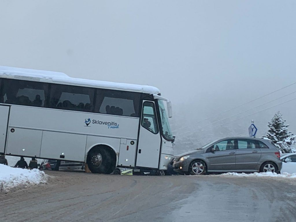 bus and car on an icy road in Greece