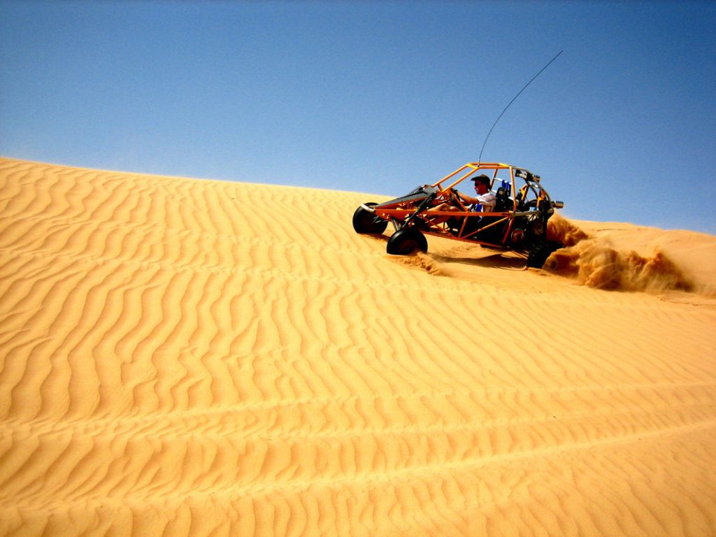 Robin Esrock driving a dune buggy in Dubai