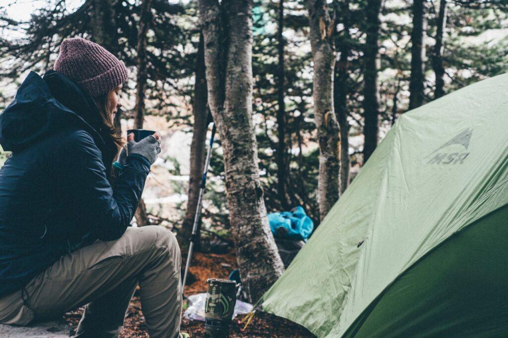 gear to bring camping, tent, warm clothing, mug