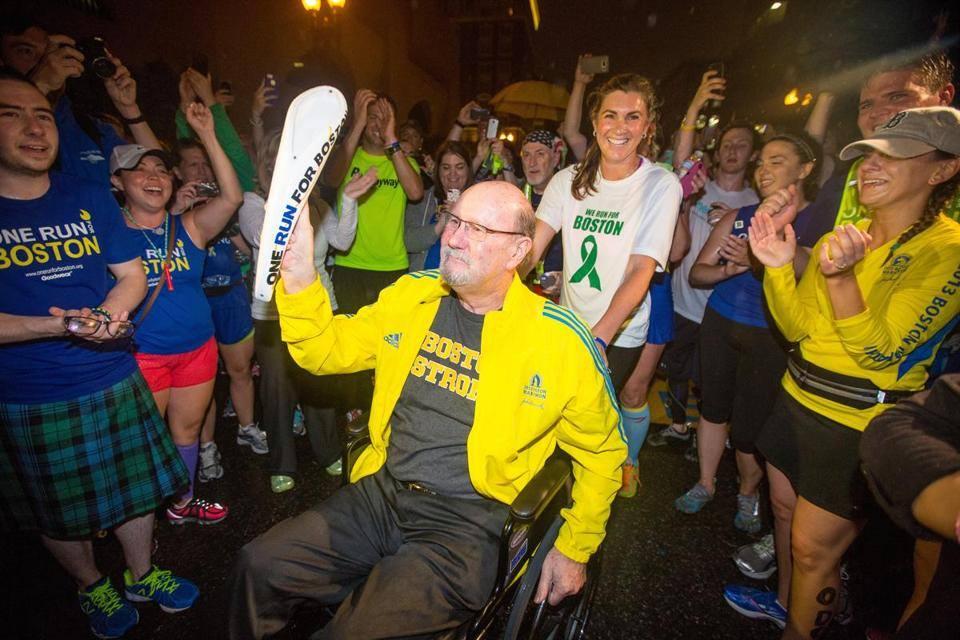 He carried the baton across the Boston Marathon finish line