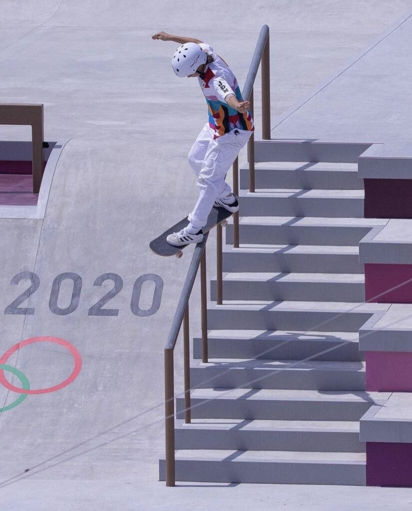 Photograph of Momiji at skateboarding olympics. Frontside feeble grind rail. Source World Skate by Atiba Photo